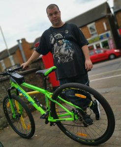 Michael with the bike he bought with his carers grant